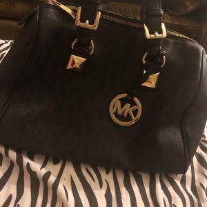 Gorgeous Pre loved Michael Kors black gold handbag